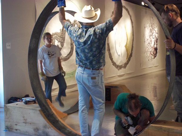 Jennifer and men assembling the East Gate sculpture, Sacred Space installation, Dougherty Arts Center