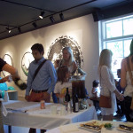 People milling around tables at opening reception of Sacred Space, Dougherty Arts Center