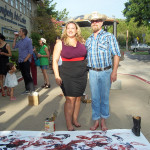 Two people, smiling, with paint on their feet, in front of the painting, Sacred Space Art Party, Dougherty Art Center