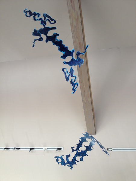 Blue Arc and Hook sculpture installed in gallery