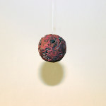 I am the Cosmos, Rose Planet Hemisphere sculpture, hanging from gallery wall