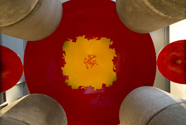 Bright red and yellow interior of Full Bloom sculpture