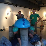 Jake Lenahan, Blake Smith, Robby Lee and Larry Vanston, helping with the heavy lifting on Full Bloom sculpture, Sacred Space installation, Dougherty Arts Center