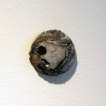 Single Hemisphere sculpture, number 2, hanging on gallery wall