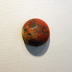 Single Hemisphere sculpture, number 4, hanging on gallery wall