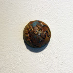 Single Hemisphere sculpture, number 7, hanging on gallery wall