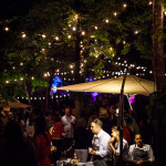 Shot of caterers under night lights, Umlauf Garden Party Event