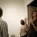 People reading the point maps at Hedonic Map exhibition opening at CoLab