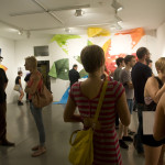 People viewing art at the opening of Right There: Hedonic Map exhibition