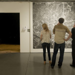 People viewing aerial map of Austin during Right There: Hedonic Map of Austin Exhibition