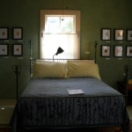 Bed with Andrea Pramuk's paintings at Fisterra Studio, EAST 2011, by Judith Simonds