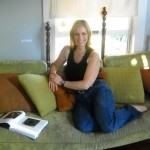 Judith Simonds on couch at Fisterra Studio, EAST 2011
