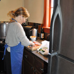 Jennifer cooking posole, EAST 2012 at Fisterra Studio by Philip Rogers
