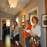 Visitors in hallway, EAST 2012 at Fisterra Studio by Philip Rogers