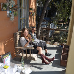 Jennifer and Stella lounging on front porch, EAST 2012 at Fisterra Studio by Philip Rogers