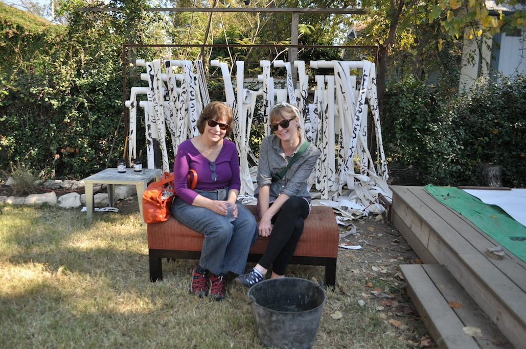 Bridget Quinn and friend on bench in back yard, EAST 2012 at Fisterra Studio by Philip Rogers,