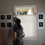 People viewing Stella's hero portraits, EAST 2012 at Fisterra Studio by Dante Dominick