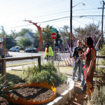 People viewing Fire Ring sculpture in front yard, EAST 2012 at Fisterra Studio by Dante Dominick