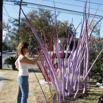 People enjoying Monique Capanelli's yard installation, EAST 2012 at Fisterra Studio by Dante