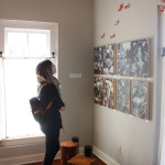 Woman viewing Stella Alesi Paintings, EAST 2012 at Fisterra Studio by Dante Dominick