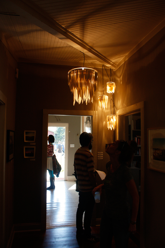 Dharmesh Patel and Autumn Ewalt's porcelain lights turned on in dark hallway, EAST 2012 at Fisterra Studio by Dante Dominick