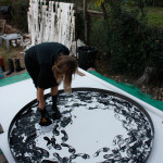 Jennifer painting with her feet using black paint, EAST 2012 at Fisterra Studio by Dante Dominick