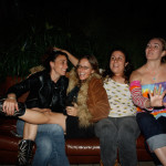 Night shot of Four happy women on a couch outside, EAST 2012 at Fisterra Studio by Dante Dominick