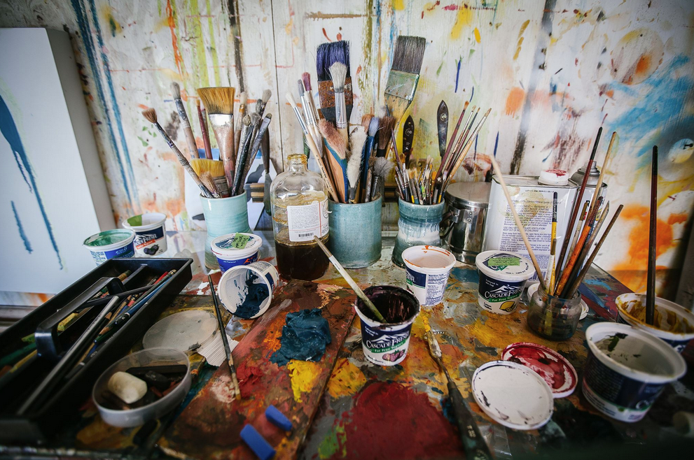 Painting tools on desk in Studio by Saundra Goldman