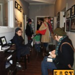 People Looking at Art in Hall, EAST 2013 at Fisterra Studio by Leslie Vela