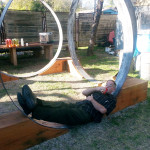 Man Relaxing in Circular Sculpture, EAST 2013 at Fisterra Studio by Dante Dominick