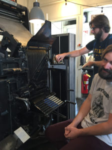 Brandon Boan demonstrating linotype machine at Tip Type